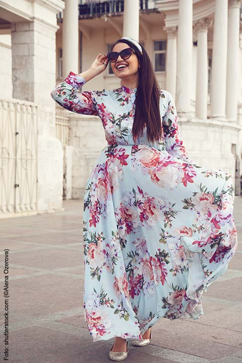 stock-photo-plus-size-model-wearing-floral-maxi-dress-posing-on-the-city-street-young-and-fashionable-493257184